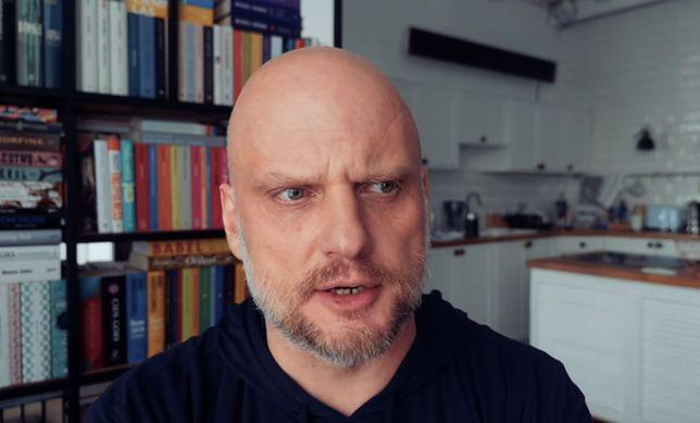 O. Adam Szustak.