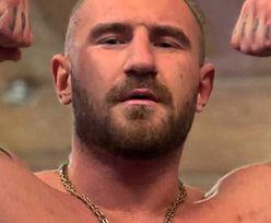Mały to on nie jest! Znany polski raper w FAME MMA. Zobacz go na siłowni