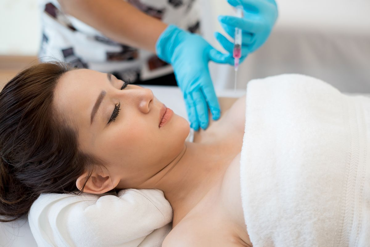 Surgery cosmetology inject botox in breast. breast, surgery, woman, beautiful, white, young, augmentation, plastic, female, beauty, adult, caucasian, shape, skin, silicone, medical, implant, girl, symbol, concept, health, human, medicine, professional, care, breast, surgery, woman, beautiful, white, young, augmentation, plastic, female, beauty, adult, caucasian, shape, skin, silicone, medical, implant, girl, symbol, concept, health, human, medicine, professional, care