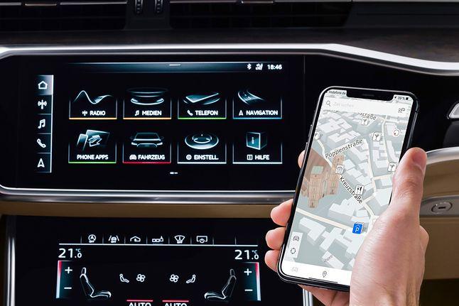 W nowej aplikacji Audi możemy cel wprowadzić w smartfonie. Zostaniemy doprowadzeni do samochodu nawigacją dla pieszych, następnie punkt docelowy zostanie automatycznie przeniesiony na nawigację w A6.