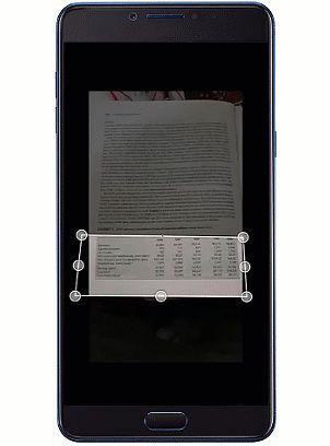 Zaznaczanie fragmentu z tabelą na zdjęciu w aplikacji Excel na Androida.