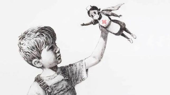 """Banksy w czasie trwającej pandemii podarował jedną ze swoich najnowszych prac szpitalowi w Southampton. Rysunek """"Game Changer"""" przedstawia chłopca, który swoje ulubione zabawki – Spidermana i Batmana – zastąpił... figurką pielęgniarki stylizowanej na superbohaterkę"""