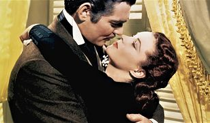 """Clark Gable jako Rhett Butler i Vivien Leigh jako Scarlett O'Hara w filmie """"Przeminęło z wiatrem"""""""