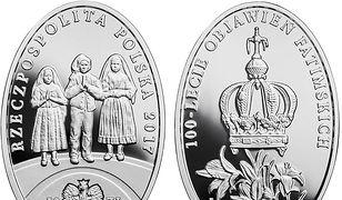 Srebrna moneta kolekcjonerska upamiętniająca 100-lecie objawień fatimskich.