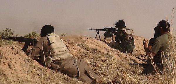 Członkowie ISIL (Islamskiego Państwa Iraku i Lewantu), które później przemianowało się na Państwo Islamskie