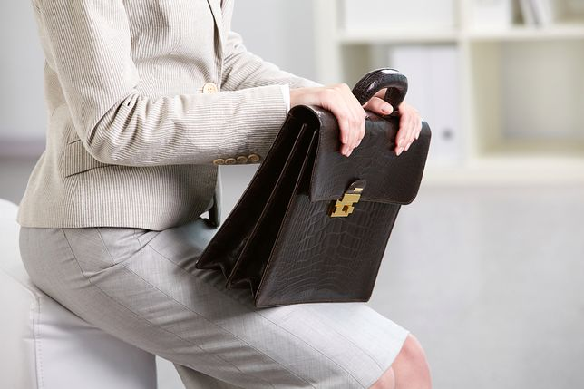 Close-up of businesswoman holding briefcase