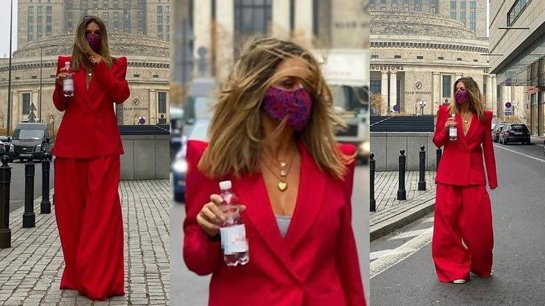 Małgorzata Rozenek włóczy szerokimi spodniami pod Pałacem Kultury, reklamując butelkę wody (ZDJĘCIA)