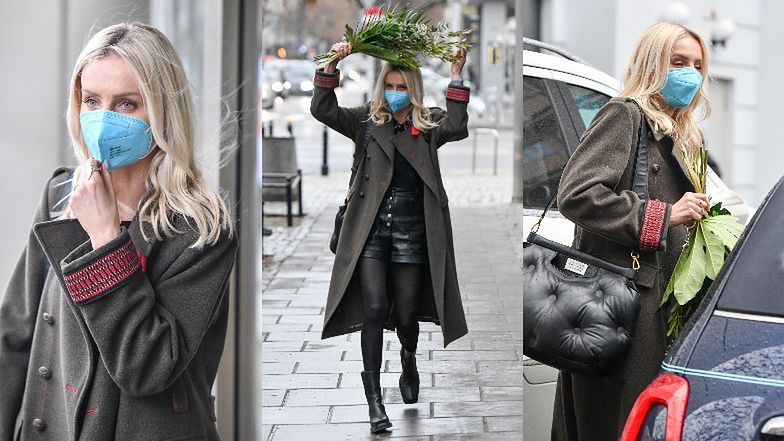Agnieszka Woźniak-Starak ratuje fryzurę przed zmoknięciem za pomocą... kwiatów (ZDJĘCIA)