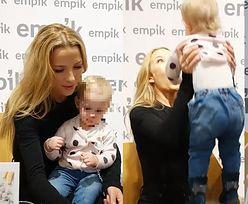 Opiekuńcza Chodakowska tuli roczną fankę podczas promocji książki