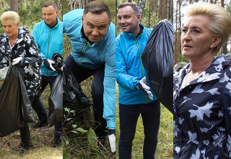 Dobrani kolorystycznie Andrzej i Agata Dudowie sprzątają las i sadzą drzewa