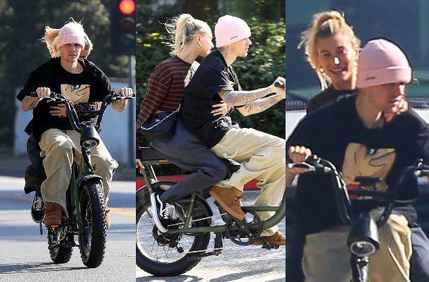 Szybki i wściekły Justin Bieber z wtuloną w plecy żoną przemierzają bulwary Beverly Hills na elektrycznym rowerze (ZDJĘCIA)