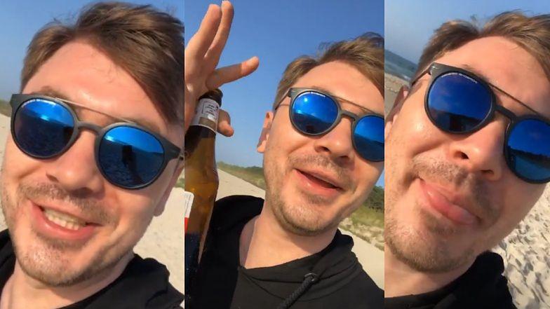 """Uradowany Daniel Martyniuk Z PIWEM W RĘCE pozdrawia znad morza o świcie: """"Chałupy welcome to!"""""""
