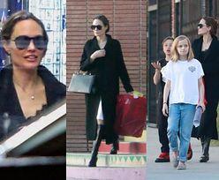 Angelina Jolie kryje się za ciemnymi okularami na zakupach z Vivienne, Knoxem i ochroniarzem