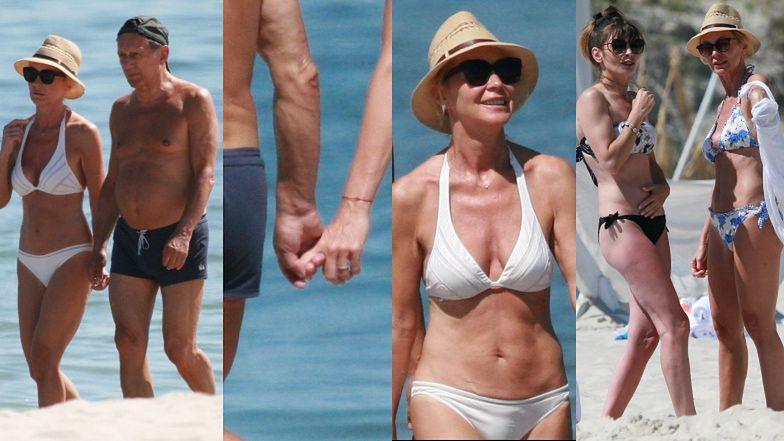 Zakochani Beata Ścibakówna i Jan Englert spacerują po plaży w Juracie
