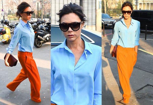 Victoria Beckham w pomarańczowych spodniach
