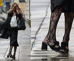Frąckowiak w klapkach Gucci za 2200 złotych zasłania twarz przed paparazzi (ZDJĘCIA)