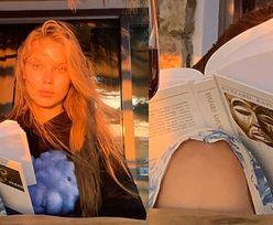 Muśnięta zachodzącym słońcem Iga Lis pozuje z książką Ryszarda Kapuścińskiego i lampką czerwonego wina (FOTO)
