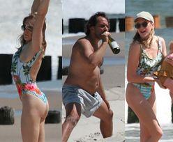 Lara Gessler i Piotr Szeląg gimnastykują JĘDRNE CIAŁKA, plażując nad Bałtykiem z córeczką Neną (ZDJĘCIA)