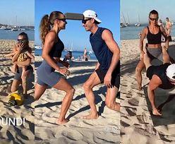 Anna i Robert Lewandowscy wyciskają siódme poty na plaży i trenują przysiady z córkami w ramionach (ZDJĘCIA)