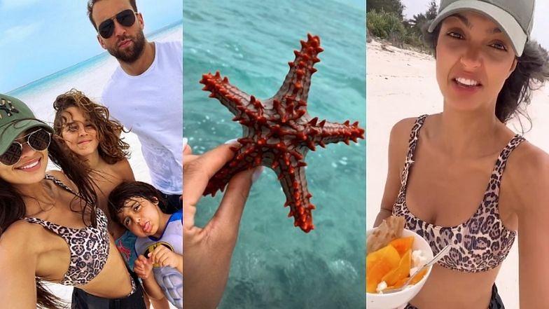 Klaudia El Dursi wyciąga rozgwiazdy z wody, żeby zrobić ładne zdjęcia na Instagrama