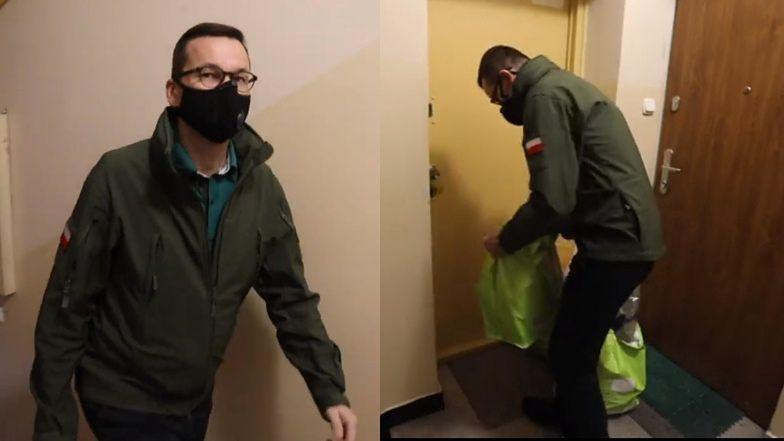 """Mateusz Morawiecki chwali się, że zanosi seniorce siaty z zakupami. Internauci: """"PIĘKNIE JAK W KOREI PÓŁNOCNEJ"""""""