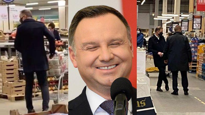 Andrzej Duda z maseczką na twarzy nabywa znicze w eskorcie ochroniarzy (ZDJĘCIA)