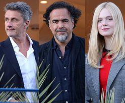 Szarmancki Paweł Pawlikowski dowcipkuje z Elle Fanning podczas spotkania jury festiwalu Cannes