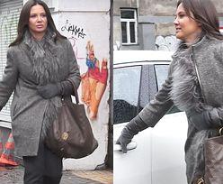 Rusin wychodzi z pracy z torebką Louis Vuitton