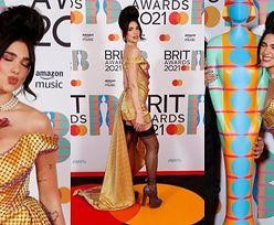 Brit Awards 2021. Dua Lipa flirtuje z obiektywami w pończochach i z gigantycznym kokiem (ZDJĘCIA)