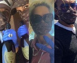 """""""Kasiaści"""" Iwona i Reggie Benjamin chwalą się butelkami szampana i podrabianymi maskami Louis Vuitton (ZDJĘCIA)"""