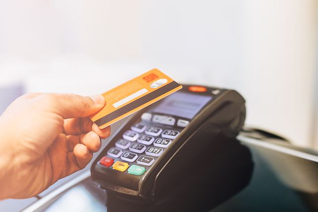 Man paying with card in a payment terminal