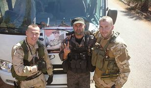 Rosjanie i żołnierz sił prezydenta Asada w Syrii