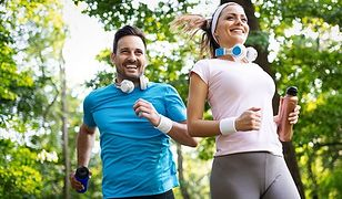 Couple jogging and running outdoors in nature, exercising together