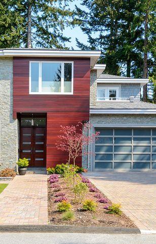 Nowoczesna elewacja domu – płyty, drewno czy szkło?