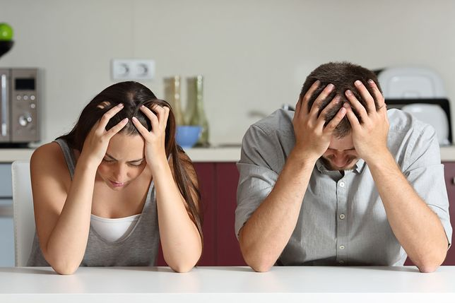 Sad and worried couple in the kitchen