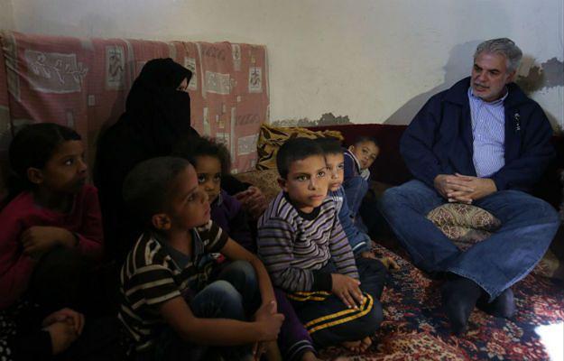 Christos Stylianides w obozie dla uchodźców koło Ammanu