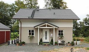 Idealny mały dom. Stonowana elewacja i tradycyjna architektura