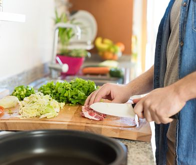 Detail of man in kitchen cooking healthy lunch