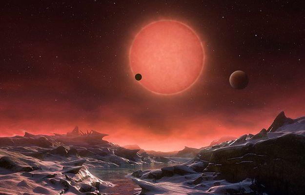 Artystyczna wizja widoku z jednej z planet krążących wokół gwiazdy 2MASS J23062928-0502285