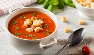 Traditional tomato soup, served with croutons. Front view.