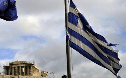 """Komisarz UE: Grecja potrzebuje """"niewielkiej dwucyfrowej liczby miliardów"""" euro"""