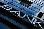 Bank Handlowy mocno tnie liczbę placówek i zatrudnienie
