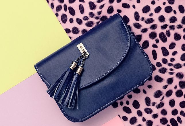Blue clutch on a stylish background. Accessories Trend
