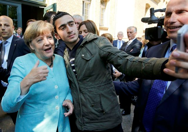 Anas Modamani z Angelą Merkel