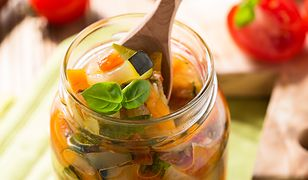Homemade healthy vegetable  preserves in glass jar, zucchini, carrots, onions and tomatoes salad