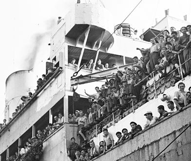 HAIFA, PALESTINE - JULY 15, 1945: The British ship Mataroa arrives with 1,204 Jewish survivors of the Nazi persecution in Europe on July 15, 1945 at the northern port of Haifa in what was the British Mandate for Palestine. (Photo by Zoltan Kluger/GPO via Getty Images)