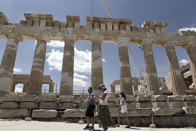 Tourist walk in front the ancient temple of Parthenon at the Acropolis hill, on June 2, 2021 (Photo by Panayotis Tzamaros/NurPhoto via Getty Images)