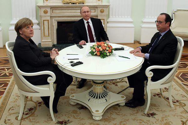 Rosyjski prezydent Władimir Putin,kanclerz Niemiec Angela Merkel i prezydent Francji Francois Hollande