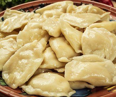 Vareniki (dumplings), pierogi - traditional Ukrainian food,Cooked and served vareniki,pyrohy or dumplings, filled with potato and served with salty caramelized onion.Close up vareniki or Russian dumplings filled with meat,homemade