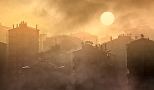 early morning silhouetted buildings in smoke, winter time